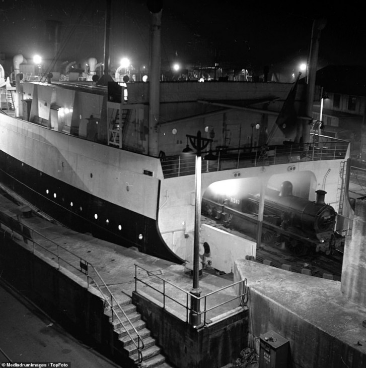 10828972-6794513-The_night_train_is_loaded_on_a_ferry_boat_at_Dover_before_embark-a-42_1552298087128.jpg
